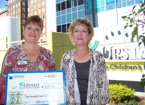 Representatives from Westar FCU making a donation at the Gollisanos Childrens Hospital.